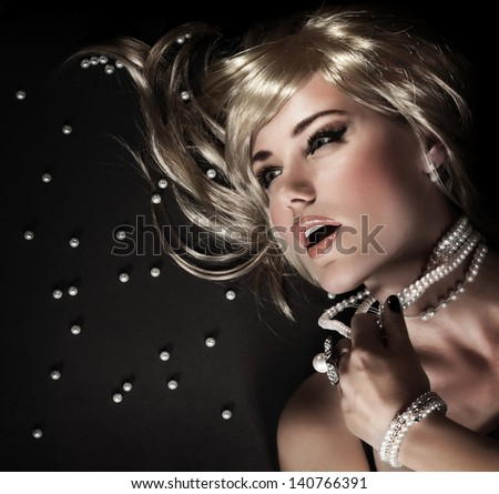 Fashion portrait of beautiful seductive woman ripped her luxury pearl beads, closeup on face with perfect stylish makeup, blond sexy female model, desire and sexuality concept  - stock photo