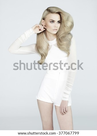Fashion portrait of beautiful sexy blonde in jeans short - stock photo