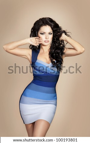 Fashion portrait of beautiful slim girl sexy woman in stylish dress with long healthy glossy hair, isolated on beige . spring summer shopping collection - stock photo