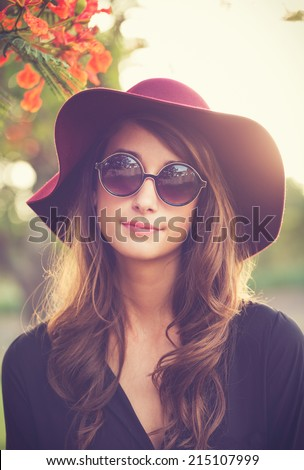 Fashion Portrait of Beautiful Stylish Young Woman in Hat and Sunglasses - stock photo