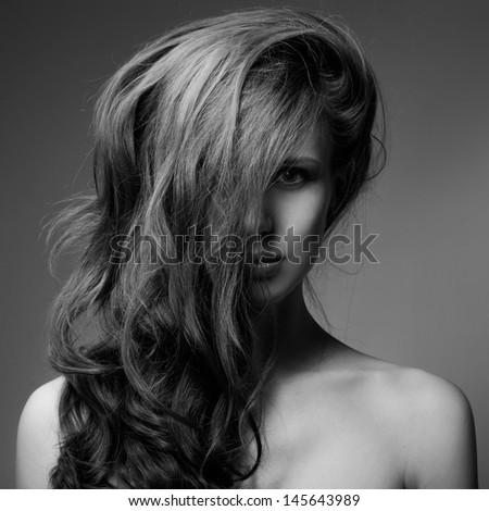Fashion Portrait Of Beautiful Woman. Curly Long Hair. BW Image - stock photo