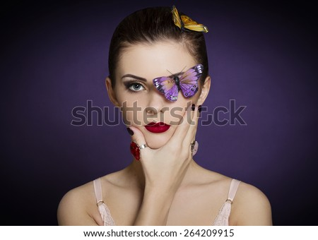 fashion portrait of beautiful woman with bright makeup and butterflies