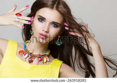 fashion portrait of beautiful woman with long hair and jewelry - stock photo