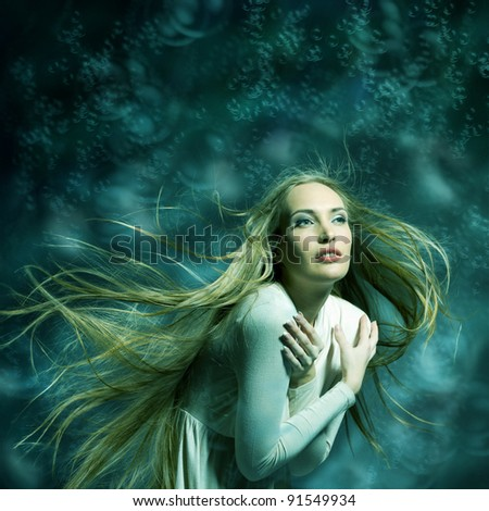 Fashion portrait of beautiful woman with streaming hair in cyan-green tones posing on bright illustrated background like mermaid - stock photo