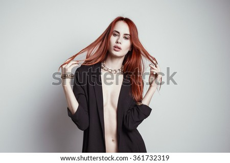 Fashion portrait of beautiful young woman with redhead. White background. - stock photo