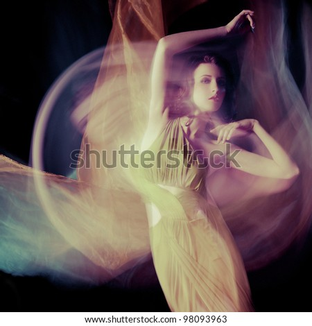 Fashion portrait of brunette lady in long dress shot in mixed light technique - stock photo