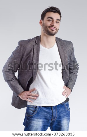 Fashion portrait of casual smiling young man