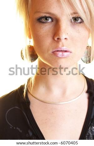 Fashion portrait of confident blond girl - stock photo