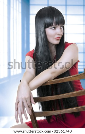 Fashion portrait of cute brunette woman in room - stock photo