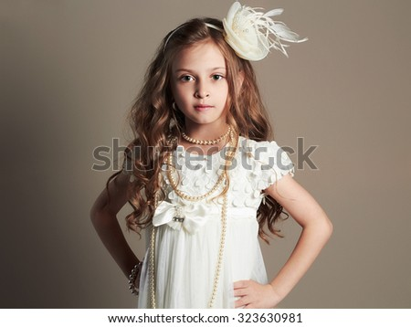 fashion Portrait of cute little girl in princess dress.beautiful child