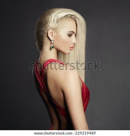 Fashion portrait of elegant blond woman in red dress - stock photo