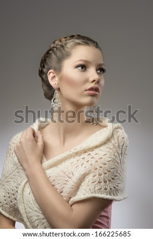 fashion portrait of elegant pretty girl with brown creative hair-style, precious earrings in emotional pose  - stock photo