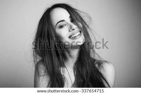 Fashion portrait of elegant woman with magnificent hair and awesome lips. Redhead girl. Perfect make-up. Hairstyle. Black and white. - stock photo