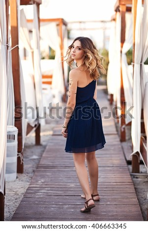 Fashion portrait of elegant woman with magnificent hair. Blond Girl in elegant dress. Flash tattoo gold - stock photo