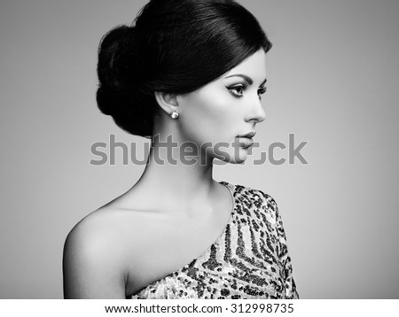 Fashion portrait of elegant woman with magnificent hair. Brunette girl. Perfect make-up. Black and white - stock photo