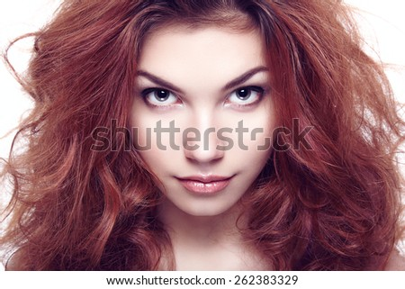 Fashion portrait of elegant woman with magnificent hair. Brunette girl. Perfect make-up. Girl on white background. Curly hair