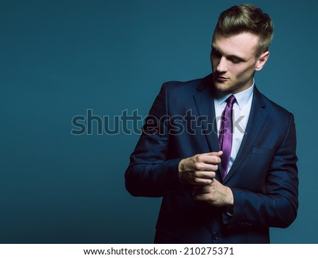 Fashion portrait of elegant young handsome man in classic costume. Copy-space - stock photo