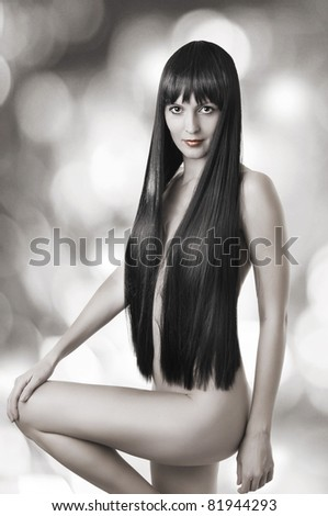 Fashion portrait of fine nude woman with long health black hair - stock photo