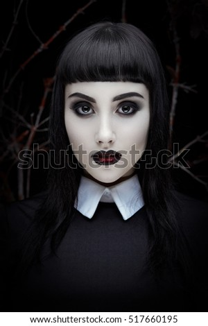 Fashion portrait of gothic young brunette girl