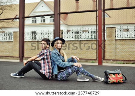 Fashion portrait of hipsters couple outdoor  - stock photo