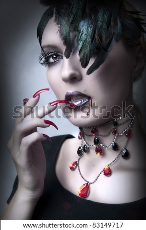 Fashion portrait of Lady vamp - vampire gothic make-up style for Halloween - stock photo