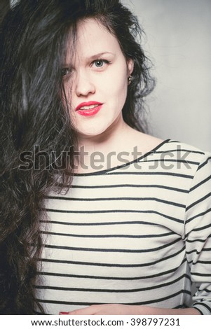 fashion portrait of long-haired beautiful brunette girl smiling - stock photo