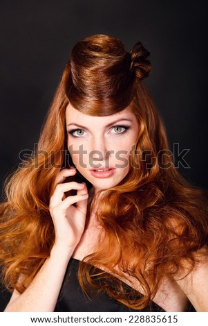 Fashion Portrait Of Luxury Woman With Red hair. hairstyle looks like a hat. - stock photo