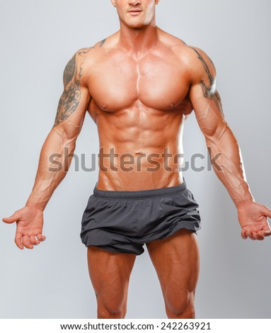 Fashion portrait of muscular male showing his body - stock photo