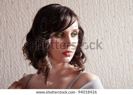 Fashion portrait of pretty young  brunette woman.