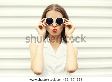 Fashion portrait of pretty young woman in white sunglasses  - stock photo