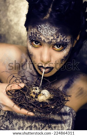 fashion portrait of pretty young woman with creative make up like a snake, halloween - stock photo