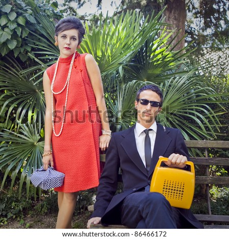 fashion portrait of retro sixties style young couple - stock photo