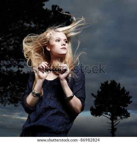 Fashion portrait of romantic woman with magnificent hair in fairy forest - stock photo