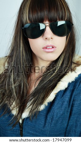Fashion portrait of sexy, young, beautiful woman wearing sunglasses