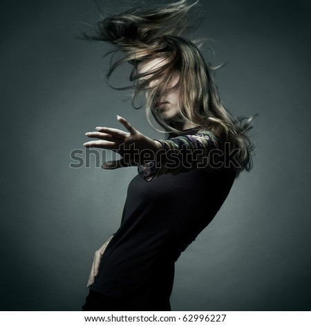 Fashion portrait of the beautiful woman with flying hair - stock photo