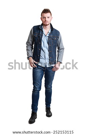 Fashion portrait of the young beautiful bearded man in studio
