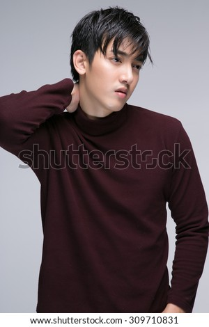 Fashion portrait of the young beautiful man look Asian - stock photo