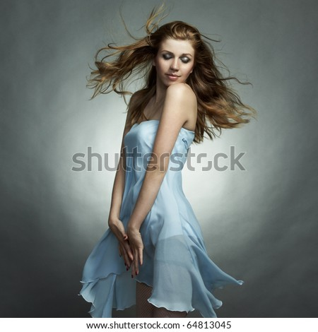 Fashion portrait of the young dancing woman - stock photo