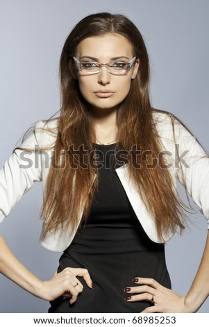 Fashion portrait of the young sexual brunette wearing eyeglasses. studio shot - stock photo