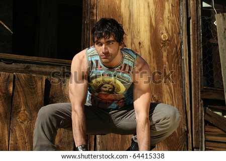 Fashion portrait of very attractive young male model with serious attitude - stock photo
