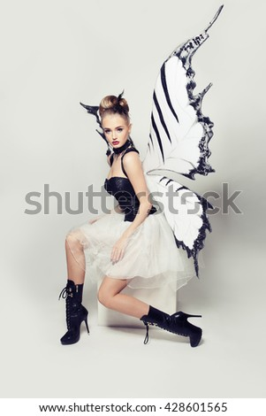 Fashion Portrait of Woman Butterfly - stock photo