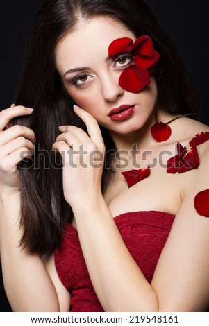Fashion portrait of woman with rose petals - stock photo