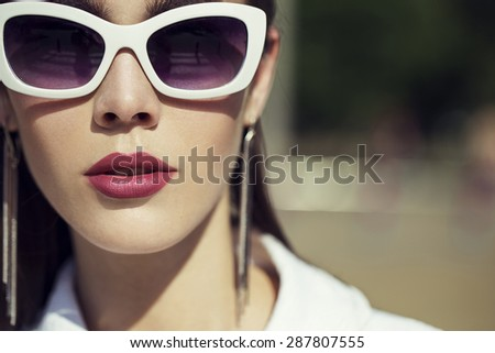 Fashion portrait of young beautiful and sexy brunette girl in trendy casual clothes, perfect skin and make up. Vogue style. Outdoor shot. Street fashion concept - stock photo