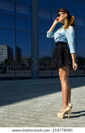 Fashion portrait of young beautiful and sexy brunette girl in trendy casual clothes. Vogue style. Outdoor shot. Street fashion and high heels concept - stock photo