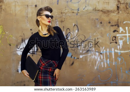 Fashion portrait of young beautiful brunette girl in trendy casual clothes and sunglasses. Vogue style. Outdoor shot. Copy space - stock photo