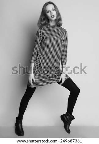 Fashion portrait of young beautiful female model  in casual dress and boots. - stock photo
