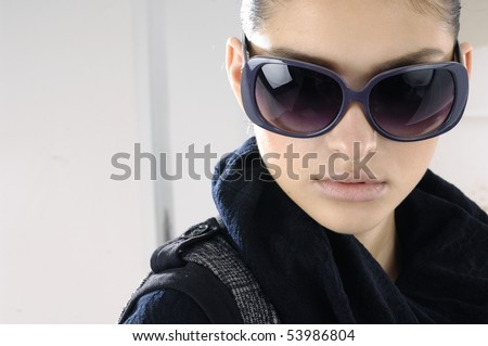 Fashion portrait of young beautiful girl wearing sunglasses - stock photo