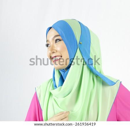 Fashion portrait of young beautiful muslim woman wearing hijab - stock photo