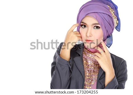 Fashion portrait of young beautiful muslim woman with purple costume wearing hijab