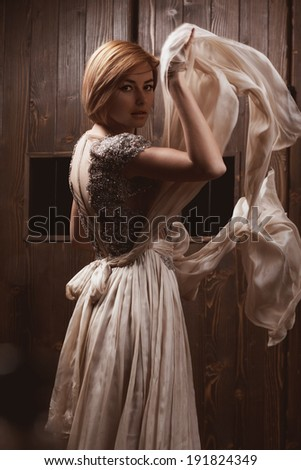Fashion portrait of young beautiful woman in the elegant dress .Romantic style photo of a beautiful blonde girl
